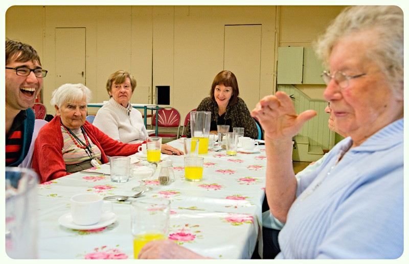 Members of the Stainbeck Lunch Club sharing stories with Matthew and Alison.